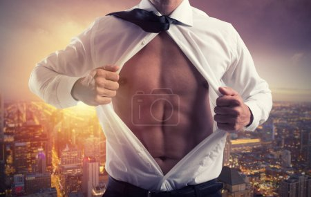 Businessman like a super hero. Concept of determination and success