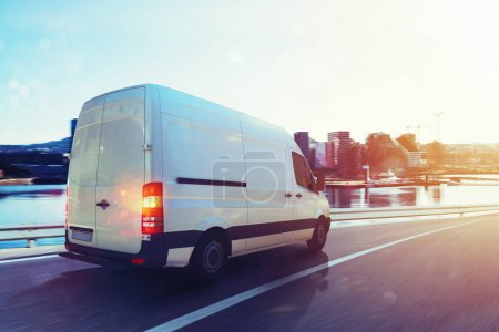 Photo for Moving van on the highway with city background. 3D Rendering - Royalty Free Image
