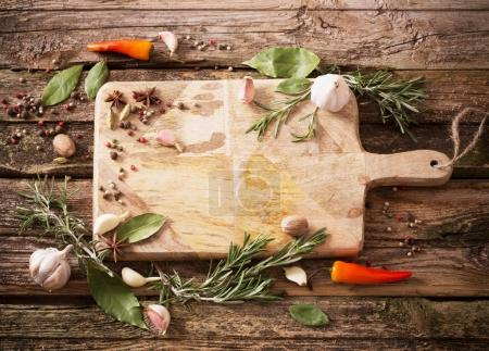 herbs and spices on a wooden background