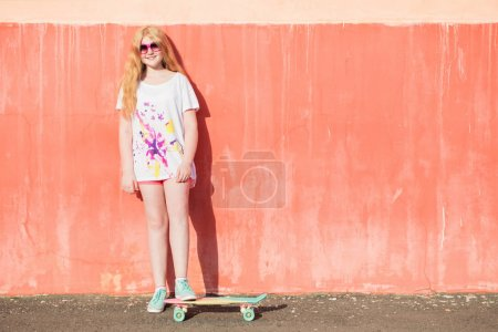 Girl teenager with skateboard