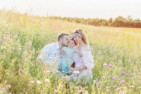 Photo for Happy family in flowers meadow - Royalty Free Image