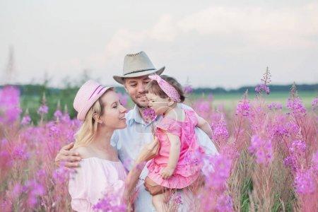 happy family in flowers meadow
