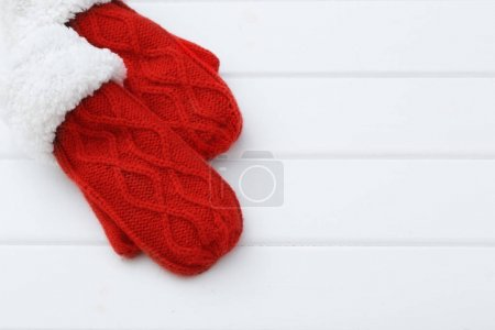 red mittens on wooden background