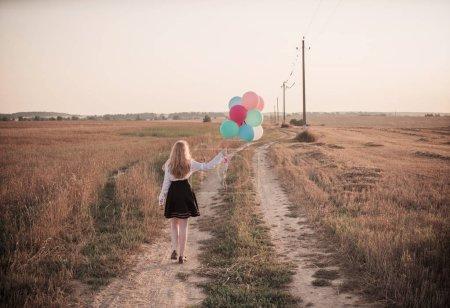 teenager balloons in summer field