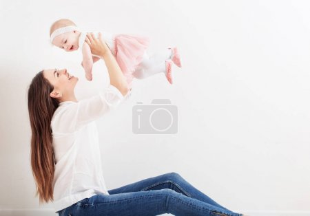 happy family mother and baby daughter