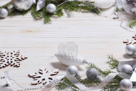 Silver Christmas decoration on wooden background