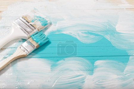 brush with paint on wooden background