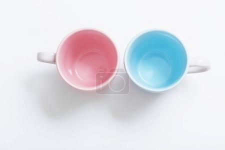 pink and blue cups on white background