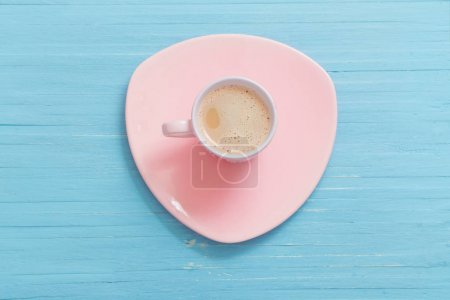 cup of coffee on blue wooden background