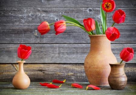 tulips bouquet on wooden table