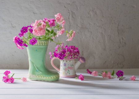 summer flowers in ceramic boot on white background