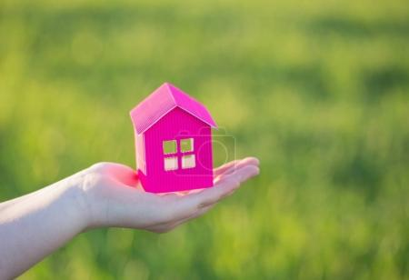 paper house in hand outdoor