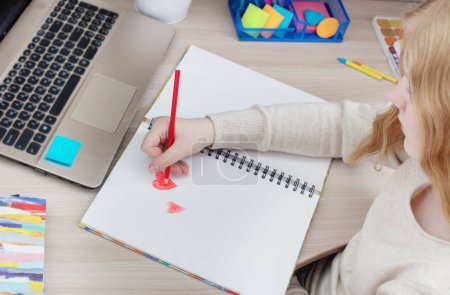 girl teenager draws red heart