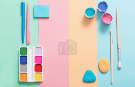 school supplies at  colorful paper background texture