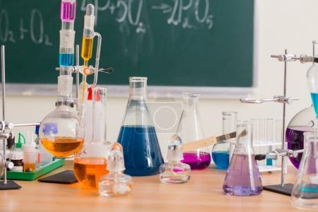 Glass flasks with multi-colored liquids at the chemistry lesson