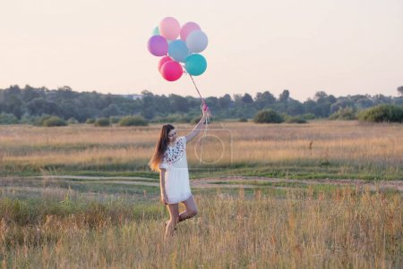 happy young women with balloons outdoor