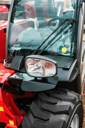 parking lights on a red tractor