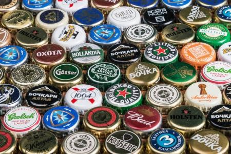 Background of beer bottle caps, a mix of various global brands