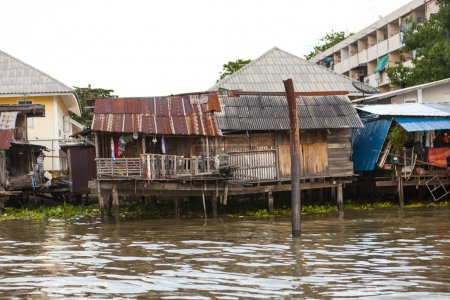 Old shacks, poor neighborhoods on the water of the river. Thailand Bangkok.