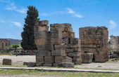 The elements of the wall of a ruined ancient house. Beautiful background of the ruins of Greek cities.