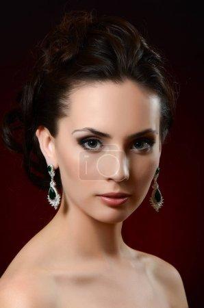 beautiful woman in jewelry earrings