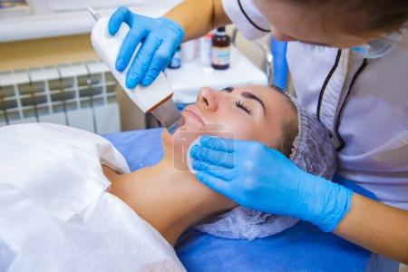 Photo for Skin Care. Close-up Of Beautiful Woman Receiving Ultrasound Cavitation Facial Peeling. Ultrasonic Skin Cleansing Procedure. Beauty Treatment. Cosmetology. Beauty Spa Salon. - Royalty Free Image