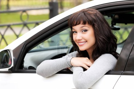 Photo for Young driver woman in white car - Royalty Free Image