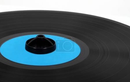 Vinyl disc with a cleaning pad.