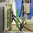 Injection molding machine ejects the finished part...
