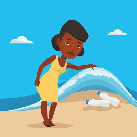 Woman showing plastic bottles under sea wave.
