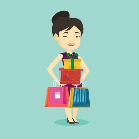 Happy woman holding shopping bags and gift boxes.