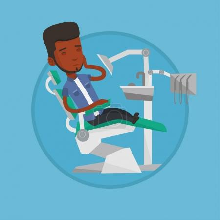 Man suffering from toothache in dental chair.
