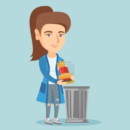 Frau wirft Junk Food in den Mülleimer.