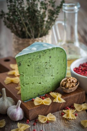 Green cheese and ingredients for Italian pasta cooking.