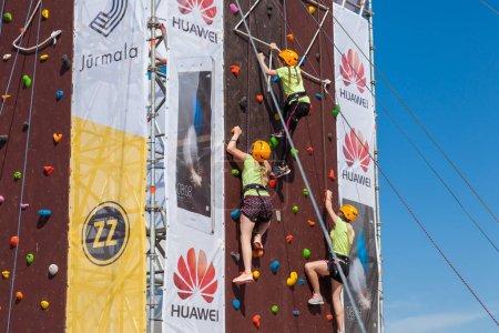 Jurmala, Latvia - 28-May-2016: children climbing competition at ZZ festival, Jurmala, Latvia.