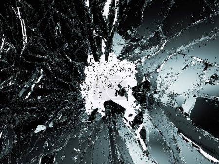 Pieces of shattered or smashed glass on white