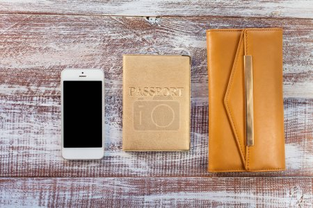 objects for travel on a wooden background.