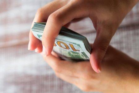 woman holding  dollars