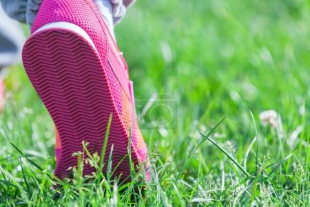 athletic foot  on a grass