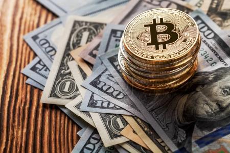 golden bitcoins and banknotes