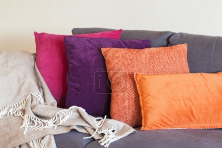 Colorful cushion on sofa cozy home autumn