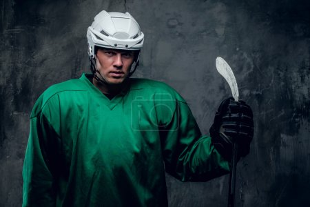 Hockey player in protective clothes