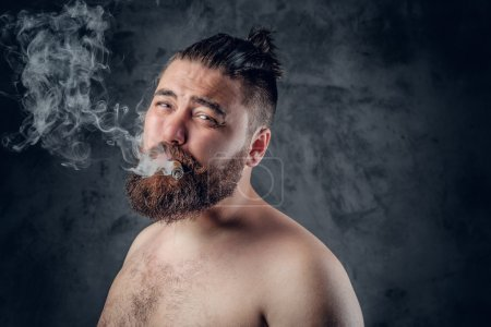 Bearded male smoking a cigar