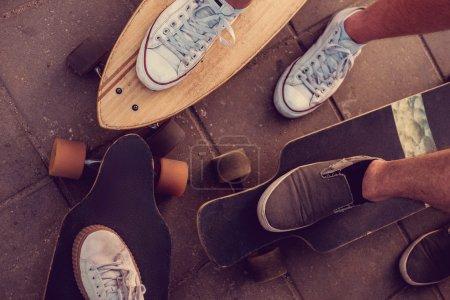 Skaters legs on longboards