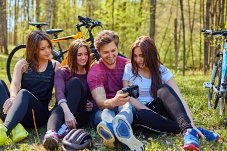 Groupe of people relaxing after bicycle ride