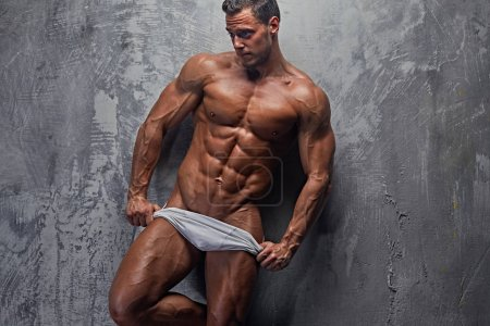 Sexy abdominal male in white panties
