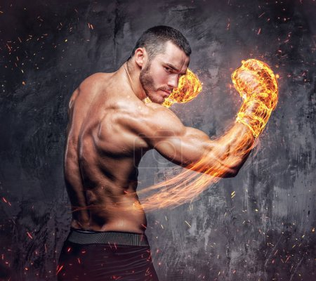 Shirtless fighter with burning boxer gloves.