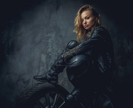 Blonde female in leather clothes