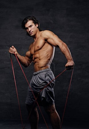 A man exercising with trx straps.