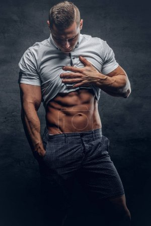 Athletic man showing six pack